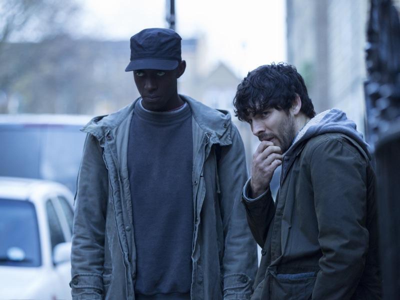 Ivanno Jeremiah as Max and Colin Morgan as Leo - Humans _ Season 1, Episode 1 - Photo Credit: Colin Hutton/Kudos/AMC/C4