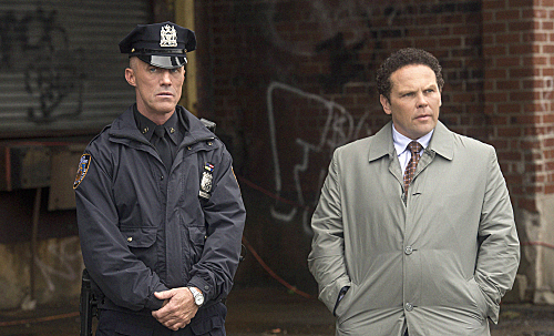 """C.O.D."" -- Officer Simmons (Robert John Burke) pressures Fusco (Kevin Chapman) to help with revitalizing the mysterious crime syndicate HR on PERSON OF INTEREST, Thursday Dec. 6 (9:00-10:00 PM ET/PT) on the CBS Television Network Photo: David Giesbrecht/Warner Bros. ©2012 Warner Bros. Television. All Rights Reserved."