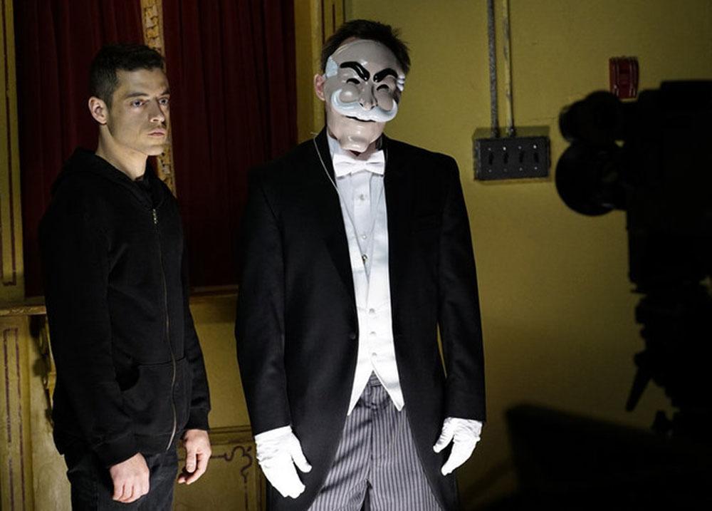 "MR. ROBOT -- ""da3m0ns.mp4"" Episode 104 -- Pictured: (l-r) Rami Malek as Elliot Alderson, fsociety -- (Photo by: Peter Kramer/USA Network)"