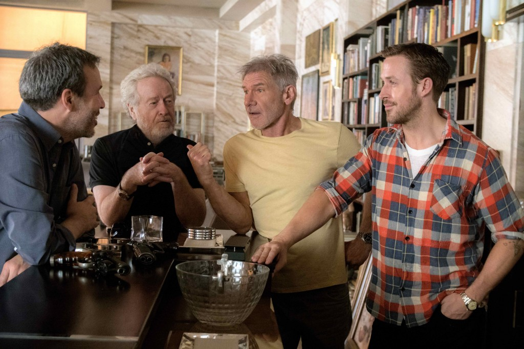 """L-r) Director Denis Villeneuve, Ridley Scott, Harrison Ford and Ryan Gosling on the set of Alcon Entertainment's """"BLADE RUNNER 2049,"""" a Warner Bros. Pictures Release."""