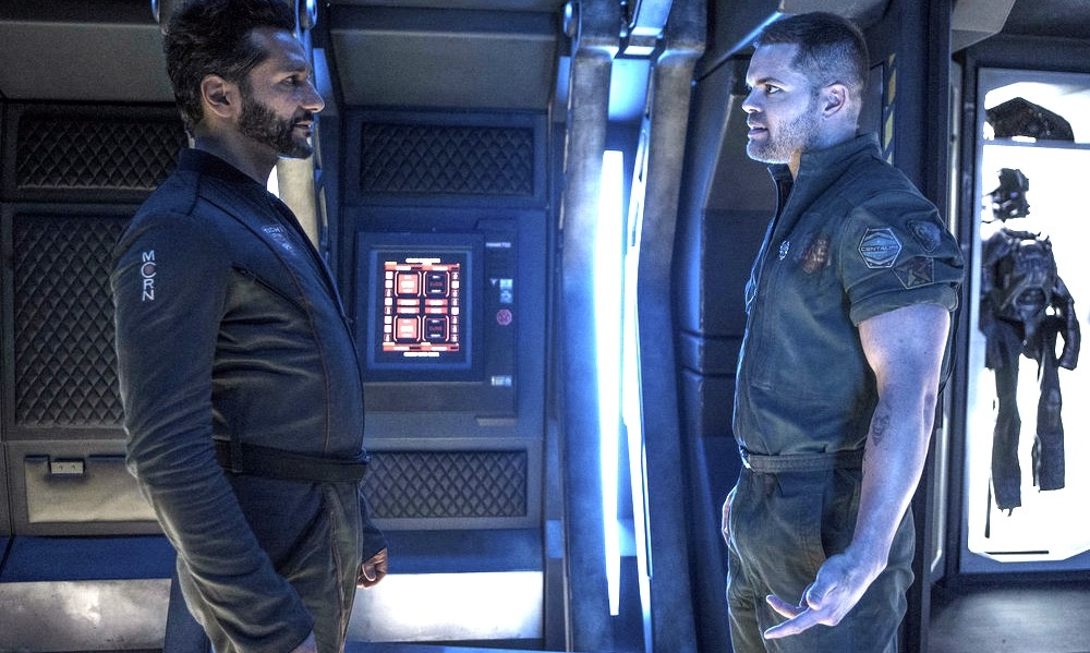 "THE EXPANSE -- ""Paradigm Shift"" Episode 206 -- Pictured: (l-r) Cas Anvar as Alex Kamal, Wes Chatham as Amos Burton -- (Photo by: Rafy/Syfy)"
